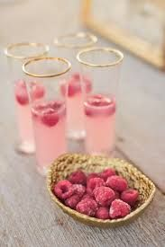Cocktail idea, beautiful glasses containing perfectly coloured cocktail for the day and love the frozen raspberries in gold!