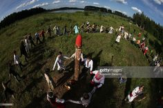 Russian neo-pagans pray celebrating the summer solstice festival called Kupalo on June 19, 2010 in a forest near Bronnitsy, 60 km east of Moscow, Russia. Hundreds of followers of slavic neo-pagan religious movements gathered in a forest to celebrate the midsummer. The festivities of Kupalo, or Kupala are known as one of the most expressive Russian folk and pagan holidays. According to their beliefs they try to reconstruct what they believe is the true religion of the Russian people that was…
