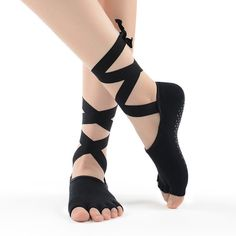 Adorable yoga/barre socks with ribbon ties. These non-slip/grip socks will add a style to your practice as you hold poses and balance. Item Type: Grip Toe Socks Fabric Type: cotton/nylon Color : black