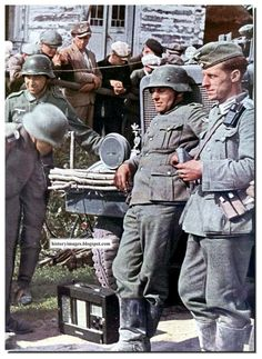 German soldiers listen to the radio in Russia