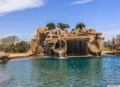 Swimming Pool Grotto Waterfall slide | ... Water Slides That Make A Lavish Swimming Pool Even Better (PHOTOS