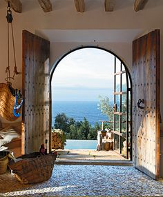 Beauitful Mallorican wooden doors leading to a stunning view