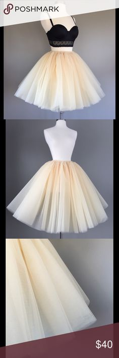 Champagne tulle skirt 24 inches long/ thirty waist/ has elastic waistband that is tulle around it/ no slip but can't tell when moved right/ looks a tad light yellow when in certain lighting but deff a champagne color. Feel free to make an offer! Skirts Midi