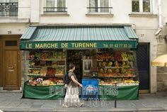 Small local grocery shop with fruit and vegetables under its awning in the Marais , Paris , France stock photo