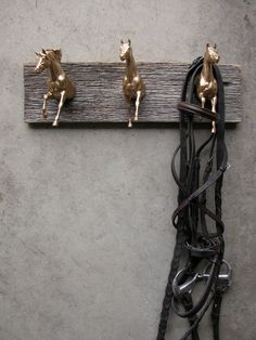 Make with Plastic Horses and spray paint gold. Could'nt hang anything heavy on it like the bridle, but could hang your Hat, Caron