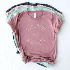 Sunshine and Whiskey crew neck t-shirt. The perfect graphic tee for a summer festival or country music concert. This soft tee is heather-style with gentle variations of gray throughout the shirt. Click through to view more styles + options! Mauve, Festival Outfits, Festival Clothing, Country Music Shirts, Shirt Designs, Tumblr T Shirt, Boyfriend Style, Christian Gifts, Christian Faith