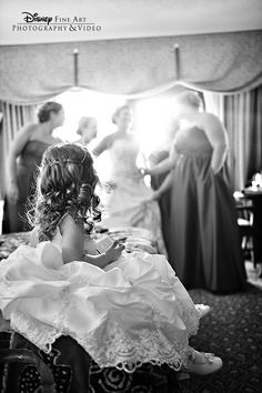 This stunning candid shot shows a flower girl gazing at the bridal party #Disney #wedding #photography