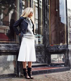 A great outfit idea for fall: whit midi, grey sweater and a leather moot jacket