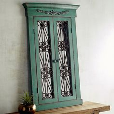 Pier 1 Imports Merville Window Mirror ($200) ❤ liked on Polyvore featuring home, home decor, mirrors, teal, european home decor, scroll mirror, teal home accessories, teal home decor and sea home decor
