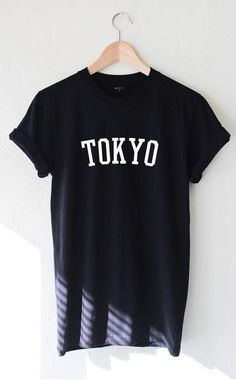 "- Description Details: Soft 100% cotton unisex & loose fit short sleeve t-shirt in black with print 'Tokyo'. Brand: NYCT Clothing. Measurements: (Size Guide) S: 36"" bust, 27"" length M: 40"" bust, 29"" l"