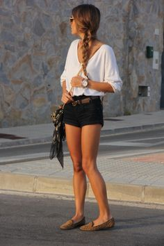 Casual chic perfection. Gorgeous loose white top tucked into tailored black shorts (definitely a must-have classic and wardrobe staple - get one!), a pretty summery side braid and gold jewellery :) :)