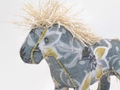 This elegant horse is perfect for the horse lover on your Christmas list. It is 7 from nose to tail, and 6 tall. The mane and tail are gold, sparkly crochet thread.    Cosmos Critters are pretty happy to be anywhere around people. They are wonderful Office Critters and are sure to the perfect addition for any cubicle or workstation. They are also quite happy to be a part of a loved collection.    All of Cosmos Critters are OOAK, and can be made in any color combination you may choose. Many…