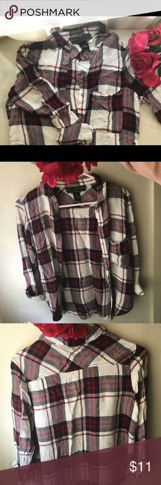 Red and white plaid button up shirt This thin plaid shirt has been sitting in my closet for a while. It could use a good ironing. It has some strings that stick out and I found a hole in the shoulder where the seam is. It's a size M, but I'm sure it will fit a small too. Polly & Esther Tops Button Down Shirts