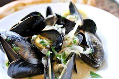 How to make perfect steamed mussels at home. Quick and easy recipe with mussels, white wine, garlic, shallots, and a splash of cream.