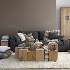 Love the ivory shag carpet, grey couch and natural elements