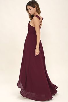 Toast to the weekend in the Here's to Us Burgundy High-Low Wrap Dress! Breezy woven fabric sweeps over a sleeveless wrap bodice with adjustable spaghetti straps, modified racerback, and tying waist sash. High-low maxi skirt has a front slit and rounded hem.