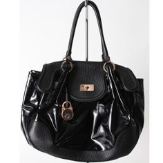 """The perfect black handbag is equivalent to the perfect LBD. This must-have Moschino  tote is black leather/patent leather & in excellent condition. There is room for all of your essentials.  Length: 20"""" Height: 12.5"""" Strap drop: 8""""  Guaranteed authenticity.   Retail: $1,090 +tax  Glamdrobe's price: $615  For inquiries email info@glamdrobe.com  #moschino #glamdrobe #instaglam #fashion #handbag #purse #tote #fashionblogger  #everydaybag #leather #designerconsignment #luxury #ootd…"""