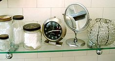 Jars for cotton products. Whats with the clock? Who has a clock in their bathroom?