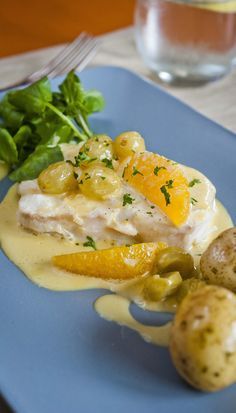 Oven Poached Halibut with Oranges and Grapes - The fruit adds some lovely sweet flavours to this creamy halibut dish - http://www.fishisthedish.co.uk/recipes/main-meals/1420-oven-poached-halibut-with-oranges-and-grapes
