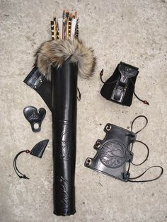 "Tooled Archery Hip Quiver, Arm Guard and Belt Pouch ""Black Raven"".    ****This is my second favorite. I love the simplicity and the color of the fur. I like that the fur is greys and browns...makes it both warm and cold."