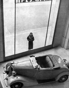 France. Renault Showroom, Champs Elysées, Paris 1934 // Robert Doisneau