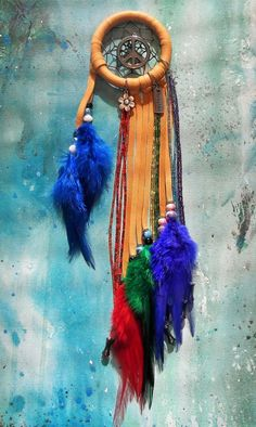 3 inch Rainbow Dream Catcher - SOLD - hand made with tan deerskin, glass beads, seed beads, hematite peace charm, blue, purple, green red hackle feathers. You can see more designs at https://www.facebook.com/pages/Dreamscape/471890606282556