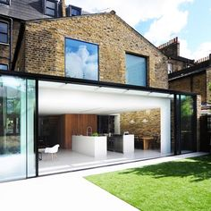 The latest projects and news from architecture studio Bureau de Change, including a London house extension with a dark blue kitchen. Orangerie Extension, Architecture Design, Architecture Origami, Contemporary Architecture, Glass Extension, Extension Ideas, Extension Google, Rear Extension, Floating Staircase