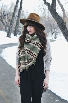 Dress up simple cardigans with a statement-making scarf and hat.