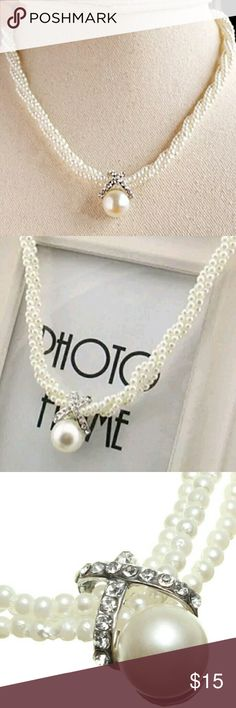 Pretty Vintage Style Pearl Choker This is a pretty three strand faux pearl choker necklace. It has a silver accents piece above a large pearl with rhinestones in center of pearl choker. Brand new. Vintage Jewelry Necklaces