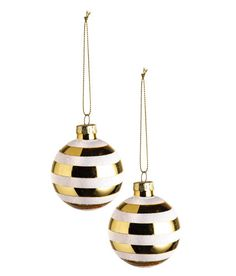 Check this out! Christmas ornaments in striped glass. Metal hanger at top with glittery cord. Diameter 2 1/4 in. - Visit hm.com to see more.