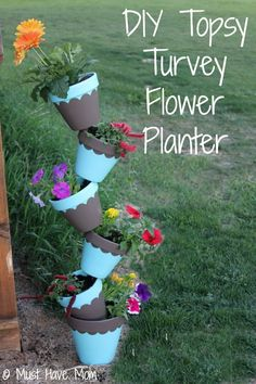 DIY Topsy Turvy Flower Planter With Step by Step Tutorial! #FrogTape #Garden | I like the way the pots are painting! not the way they are stacked.