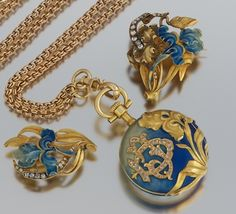 French 18 K gold ladies watch, chain, slide and brooch, all with diamonds and enamel work.  late victorian period, circa 1900
