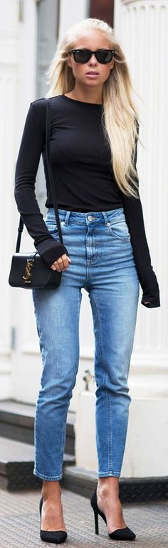 Victoria Tornegren is wearing a black long sleeved H&M top with a pair of light wash Asos jeans, NLY heels and a YSL sidebag