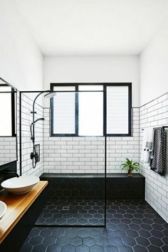 Midcentury Modern Bathroom Tile Ideas Midcentury bathroom where white subway tiles meet black hexagon tiles.Midcentury bathroom where white subway tiles meet black hexagon tiles. Modern Bathroom Tile, Bathroom Renos, Bathroom Black, Bathroom Designs, Bathroom Vanities, Bathroom Layout, Bathroom Cabinets, Bathroom Renovations, Modern Bathrooms