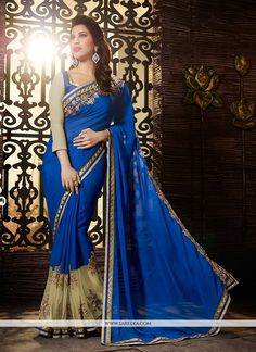 Get the simplicity & grace with this Sophie Chaudhary blue jacquard and georgette designer saree. This attire is nicely designed with embroidered and patch border work. Comes with matching blouse. (Sl...