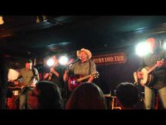 """Alan Jackson allowed 100 special people to attend a small intimate show at the famous Station Inn in downtown Nashville on 8/27/13. His new project """"The Bluegrass Album"""" features 8 original songs wrote by AJ and also a variety of great traditional bluegrass tunes. Here he his playing a song he originally cut on his """"Who Am I"""" album called """"Let's Get Back To Me and You"""". He put this song on the album and added a bluegrass picking feel to it."""