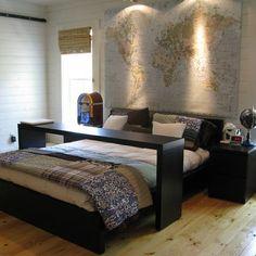 Fantastic bedroom decor. Giant map above bed, black simple furniture