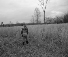 """Walking""  She pushes on through the tall grass, towards some distant destanation...  -Corhanna Photography"