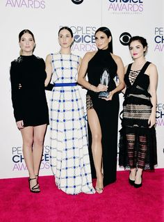 """Ashley Benson, Troian Bellisario, Shay Mitchell and Lucy Hale, winners of Favorite Cable TV Drama for """"Pretty Little Liars"""", pose in the press room during the People's Choice Awards 2016 at Microsoft Theater on January 6, 2016 in Los Angeles, California."""