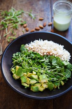 Green Goddess Detox Salad - avocado, almonds, spinach, pea shoots, and healthy homemade Green Goddess dressing