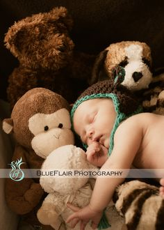 Photo idea when taking pictures of a infant boy... I will have to find Cooper a lot of stuffed horses but I think it would cute!!!!!!