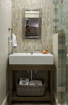Powder Room Vanity Style and Wall of Rustic Tile (to mimic the stone of the exterior)
