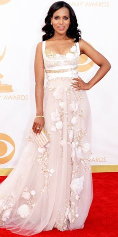 KERRY WASHINGTON Washington went the romantic route in a dreamy embellished Marchesa number with floral appliques separates and a long tulle train that she accented with a striped ivory-and-nude Edie Parker clutch, vintage Movado watch and Fred Leighton jewelry.