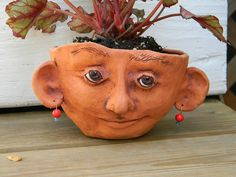 face pot with stain added by jburns711, via Flickr ...love this idea
