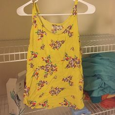 Yellow floral tank top Yellow tank top with purple floral design, scoop neck Old Navy Tops Tank Tops