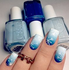 Discreet blue ombre with smooth transitions. White flakes were decoration and for this manicure. Cared nails say a lot about you, so try that always be dressed up.
