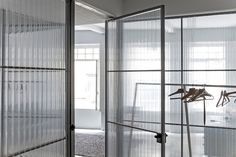 Corrugated plastic walls and concrete floor at the Miss'Opo guest house in Porto, Portugal                                                                                                                                                     More