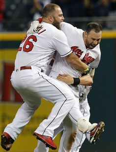 Cleveland Indians first baseman Mike Napoli congratulates  second baseman Jason…