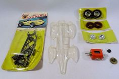 Parts and pieces that make up the Classic Astro V slot car from the 1960's.