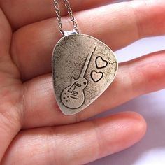 Guitar pick/plectrum necklace LOVE THIS WANT NOW